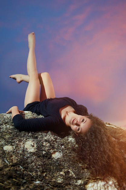 Young, curly dancer posing Photo | Premium Download