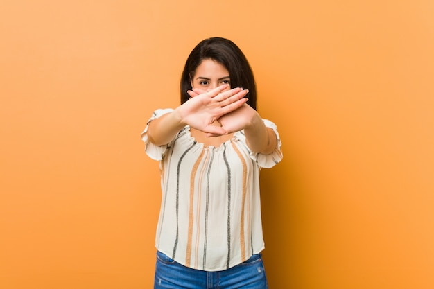 Young curvy woman doing a denial gesture Premium Photo