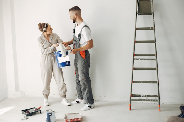 The young and cute couple repairs the room Free Photo