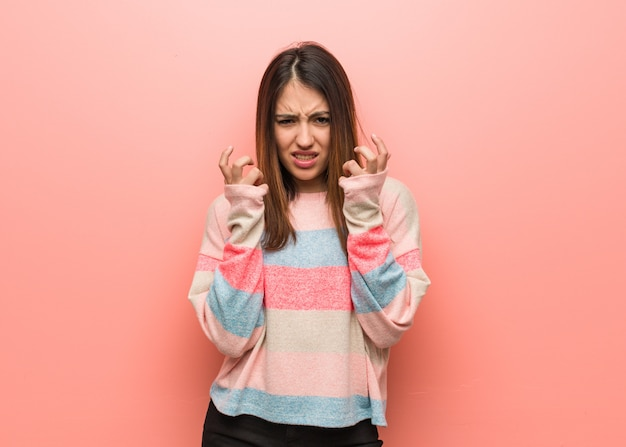 Young cute woman angry and upset Premium Photo
