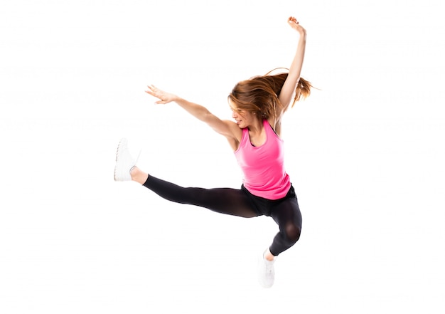 Young dance girl over isolated white background jumping Premium Photo