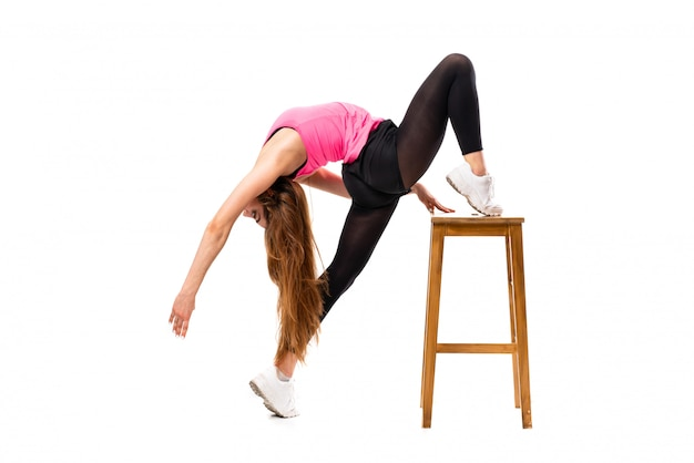 Young dance girl over isolated white background stretching Premium Photo
