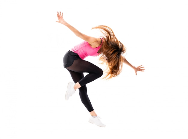 Young dance girl over isolated white  jumping Premium Photo
