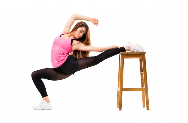 Young dance girl over isolated white  stretching Premium Photo