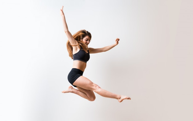 Young dance girl over isolated white wall Premium Photo