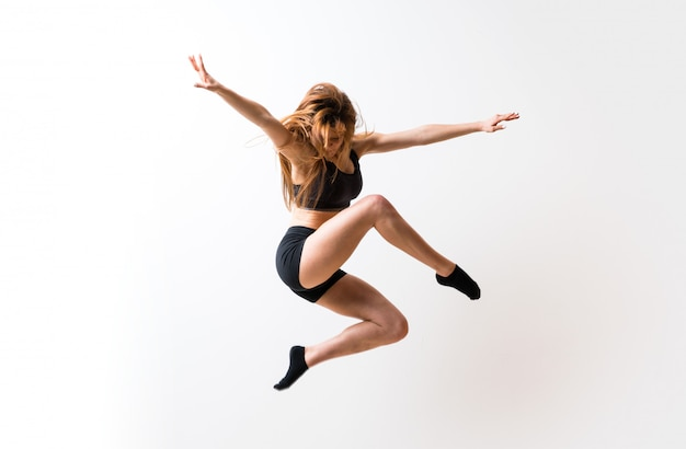 Young dance girl  isolated white wall Premium Photo