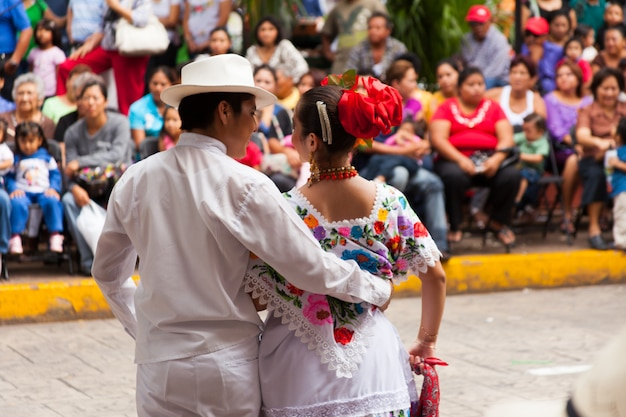 Young Dancers Performing In Front Of The Crowd At The Vaqueria At Merida City Festival. Premium Photo