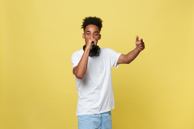 Young dark-skinned man with afro haircut in white t shirt, gesticulating with hands Premium Photo
