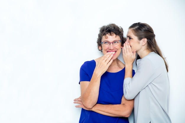 Young daughter and senior mother sharing secrets 1262 2178