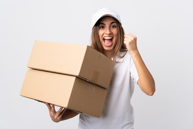 Young delivery woman over white wall celebrating a victory in winner  position | Premium Photo