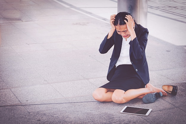 Young depressed businesswoman sitting on the floor Premium Photo