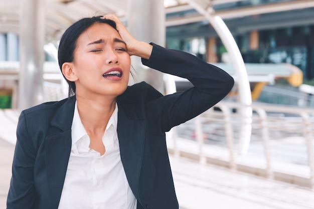 Young depressed businesswoman Premium Photo