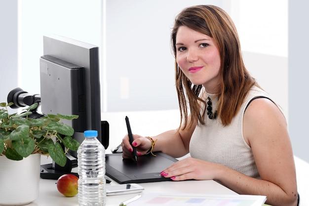 Young designer using graphic tablet Premium Photo