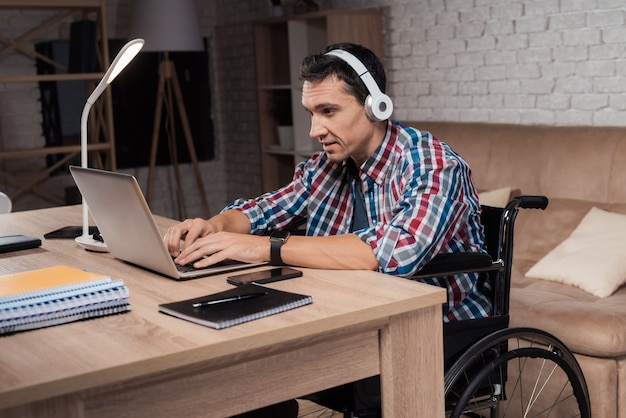 A young disabled man works at home. Premium Photo