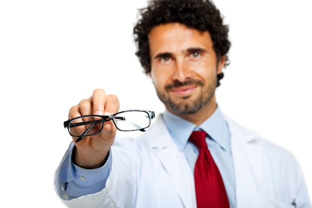 Young doctor giving you a pair of eyeglasses Premium Photo