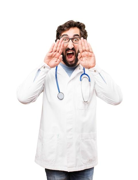 Young doctor man shouting Free Photo