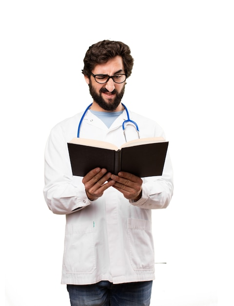 Young doctor man with a book Free Photo