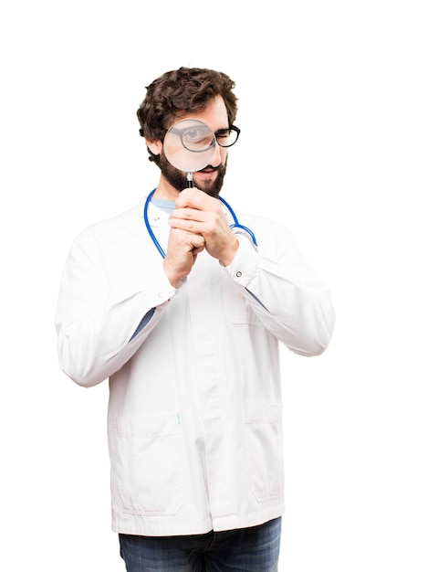 Young doctor man with a magnifying glass Free Photo