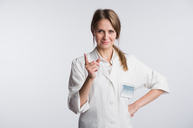 Young doctor woman nurse presenting and showing copy space for product or text. caucasian female medical professional isolated Premium Photo