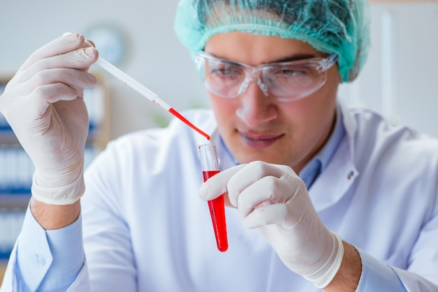 Young doctor working on blood test in lab hospital Premium Photo