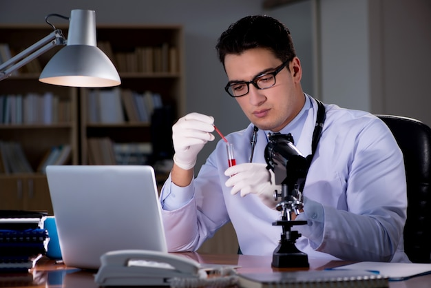 Young doctor working late in the office Premium Photo