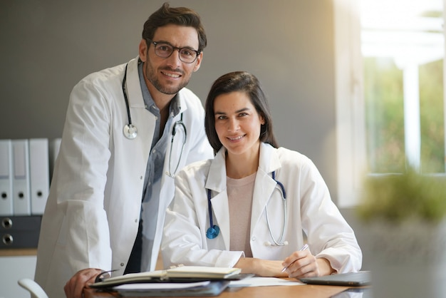 Young doctors in lab coats smiling Premium Photo