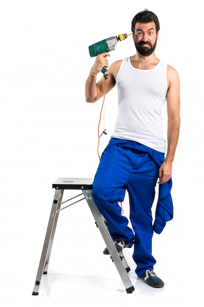 Young electrical technician with a drill making suicide gesture Free Photo