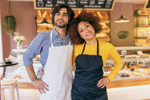 Young entrepreneur couple, they have just opened their bakery. Premium Photo