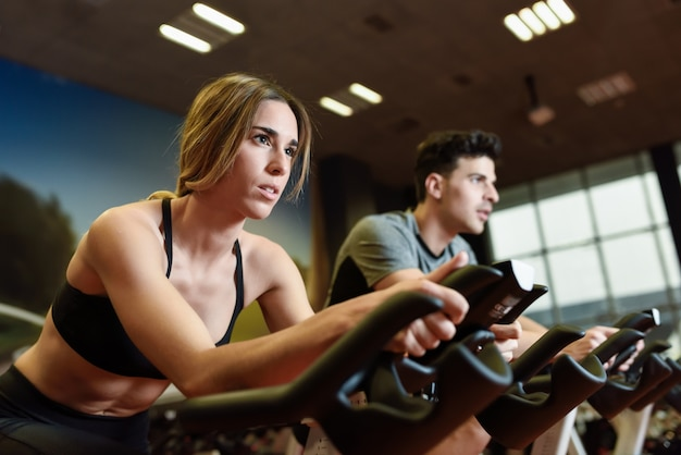 Young equipment working fitness spin Free Photo