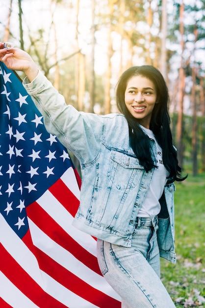 Young ethnic woman waving usa flag Free Photo