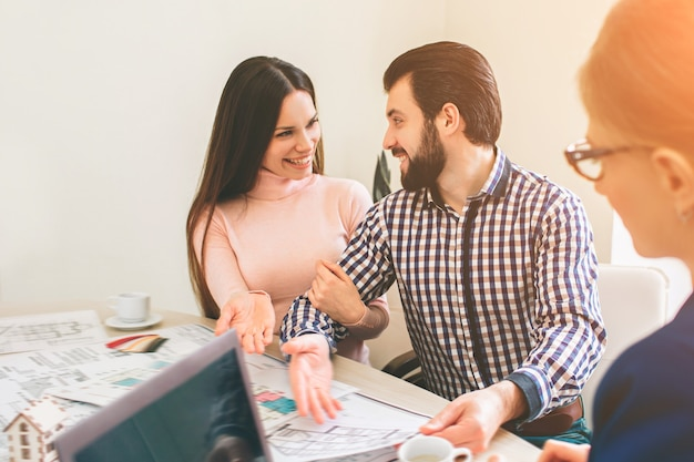 Young family couple purchase rent property real estate. agent giving consultation to man and woman Premium Photo
