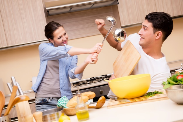 Young family doing funny fight at kitchen Premium Photo