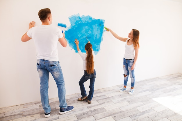 Young family makes repairs. Premium Photo