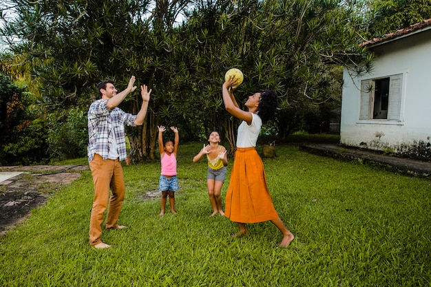 Young family playing ball in the park Free Photo