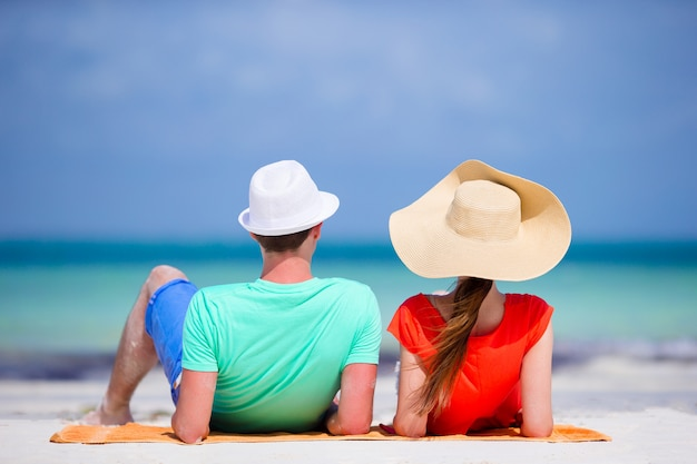 Young family of two on white beach during summer vacation Premium Photo