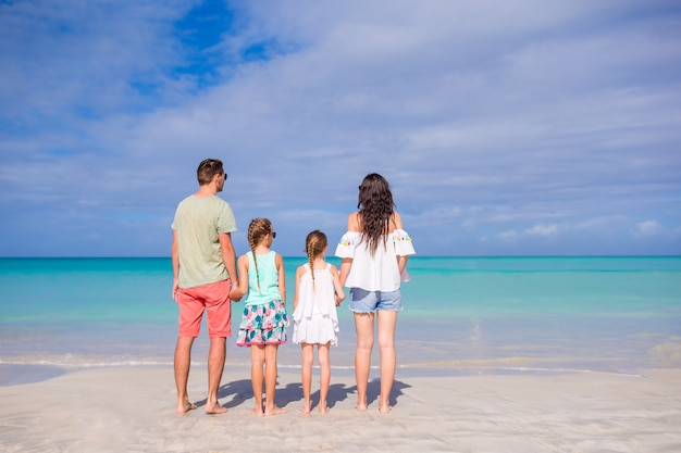 Young family on vacation on the beach. family travel concept Premium Photo