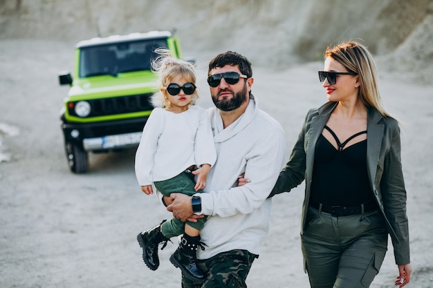 Young family with little daughter travelling by car Free Photo