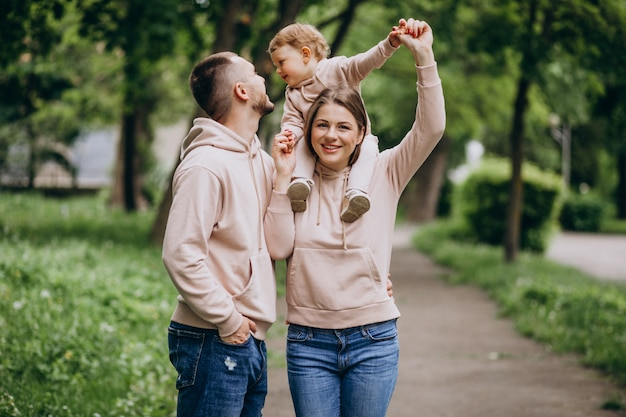 Young family with their little baby child in park Free Photo