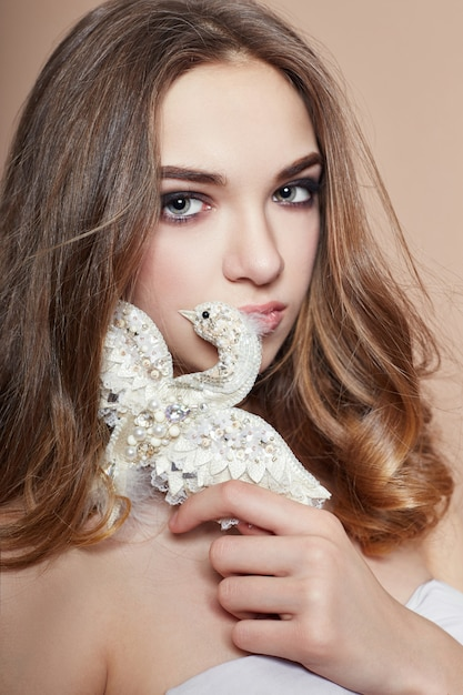 Young fashion blonde girl and brooch bird jewelry Premium Photo