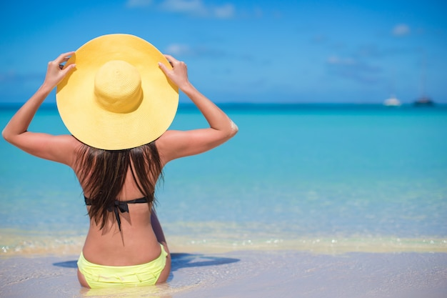 Young fashion woman in hat on the beach Premium Photo