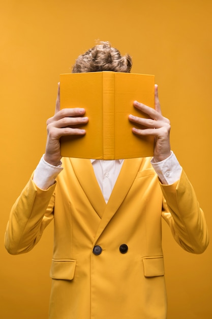 Young fashionable man reading a book Free Photo