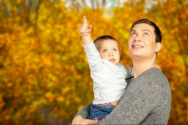 Young father and his smiling son hugging and enjoying time together, father's day celebration Premium Photo