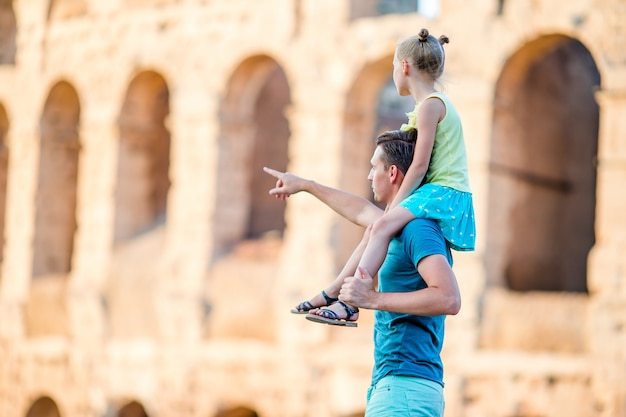 Young father and little girl background colosseum, rome, italy Premium Photo