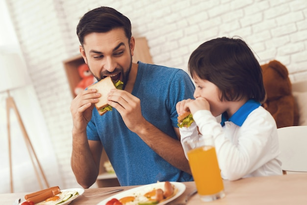 Young father and son have a breakfast. Premium Photo