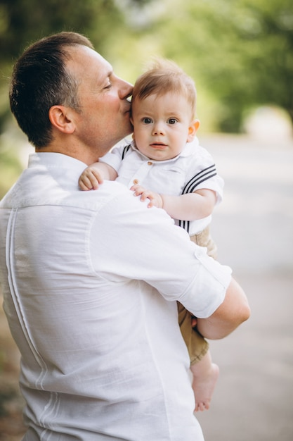 Young father with little son in park Free Photo