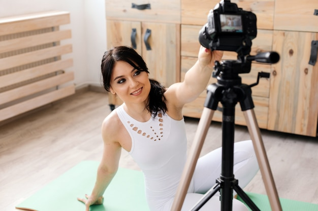 Young female blogger recording sports video at home Premium Photo