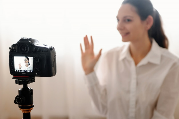 Young female blogger with camera Premium Photo