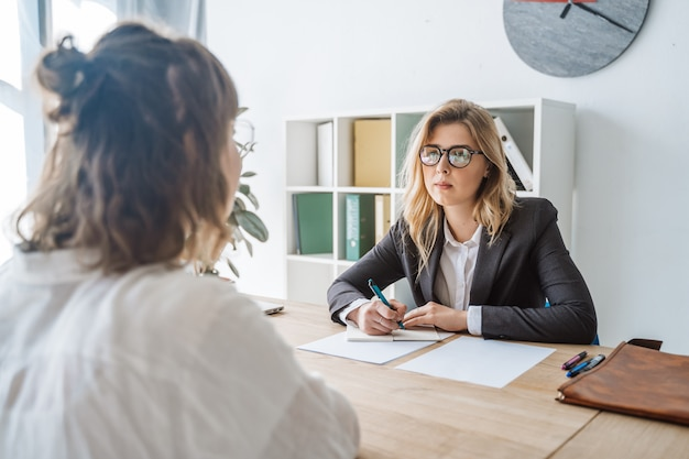 Young female candidate interviewed by employer Free Photo