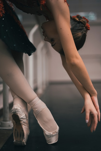 Young female dancer of classic ballet practising in the dance studio Free Photo