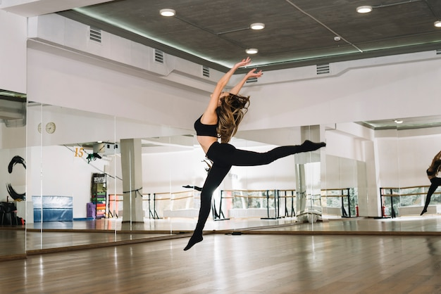 Young female dancer practising in the dance studio Free Photo